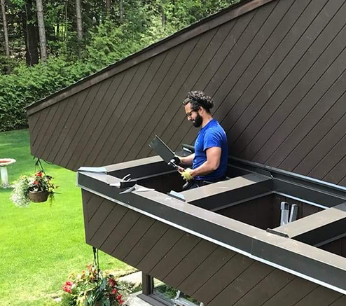 Toronto roofing contractor standing inside roof of Toronto home