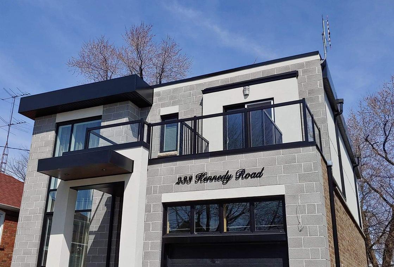 Modern Toronto home with custom sheet metal railings