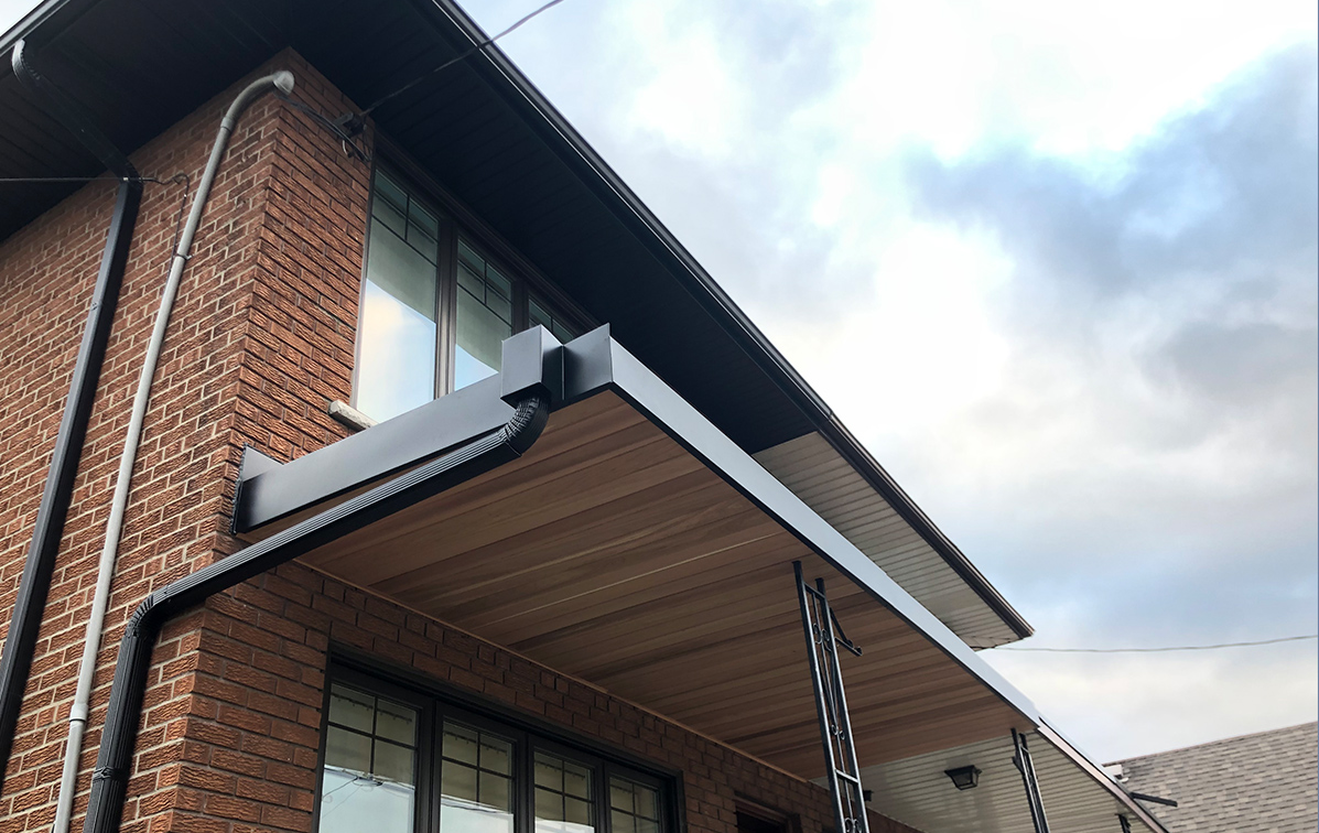 Entrance of Toronto home with fiber cement siding on overhang