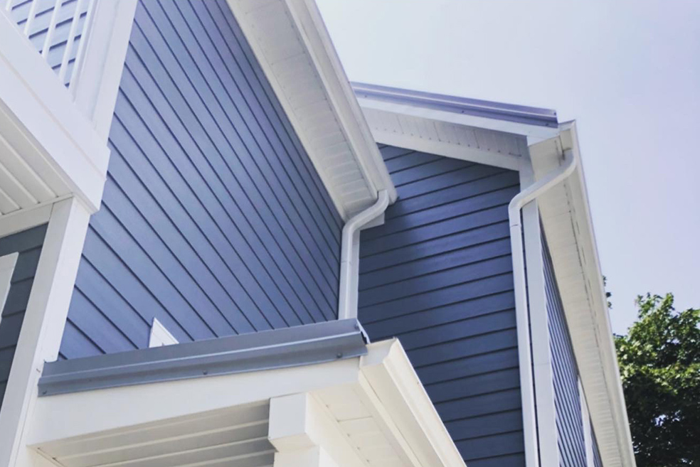 Close-up of bright blue aluminum siding on Toronto home